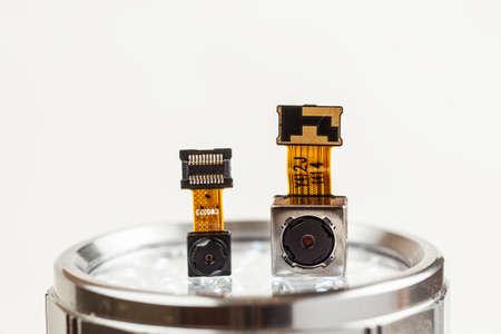 Smartphone camera modules on a white background, closeup