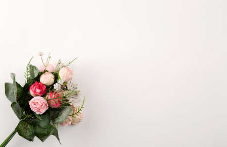 Roses bouquet on a white background top view Stock Photo