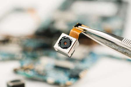 Smartphone camera module in repair shop, macro shot