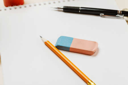 Pencil and eraser on a blank sheet of paper, selective focus Stock Photo