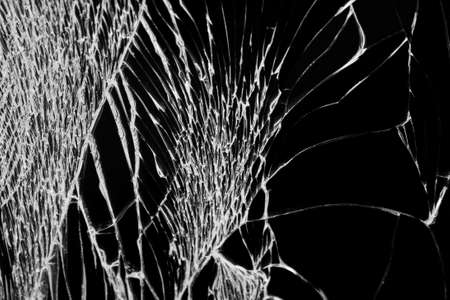 Broken display with white cracks macro shot, abstract texture