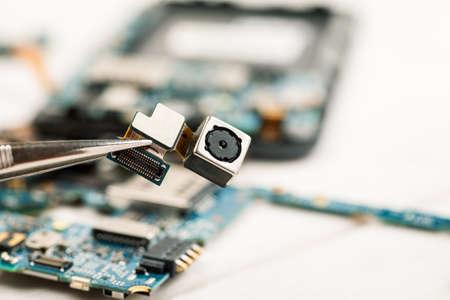 Smartphone camera module in repair shop, macro shot Stock Photo