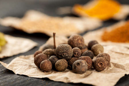 Allspice on a piece of paper macro shot Stock Photo
