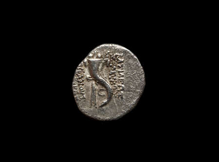Ancient silver coin isolated on black