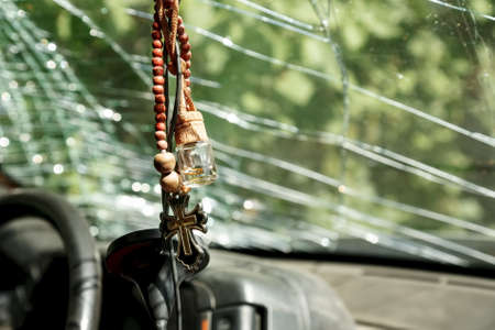 Religious accessories in the interior of a car, damaged in the accident 免版税图像