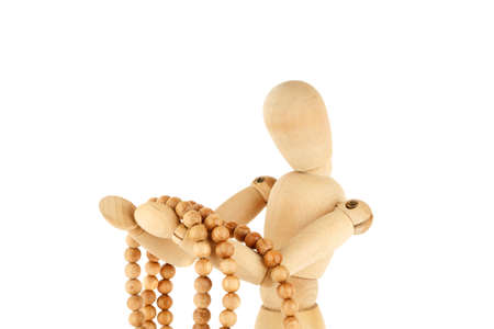 Wooden dummy holding rosary isolated on white