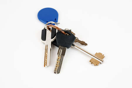 Bunch of metal keys isolated on white 版權商用圖片