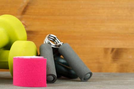 Sport equipment on a wooden table, closeup shot 写真素材