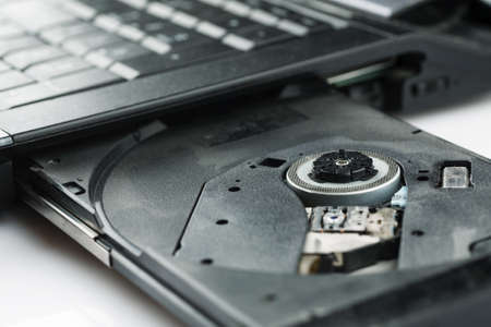 Open cd tray of laptop closeup shot Stock Photo - 122248678