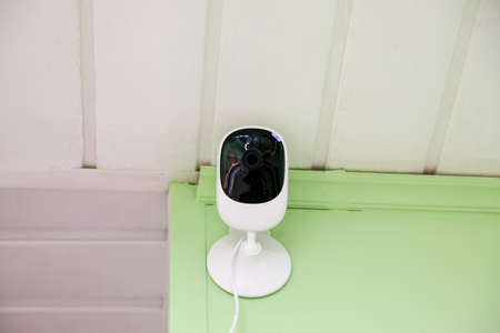 Security indoor camera on the wall in office 写真素材