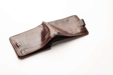 Empty old leather wallet isolated on white