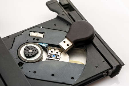 Usb flash drive inside open cd tray of laptop