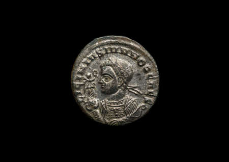 Ancient roman coin with portrait of emperor isolated on black 写真素材