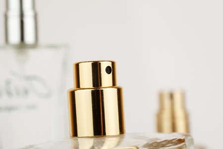 Closeup shot of perfume glass bottle on white