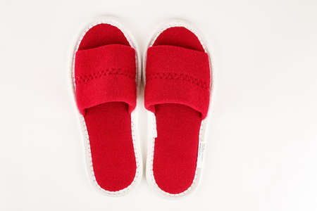 Red soft slippers isolated on white