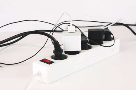Overloaded power boards on a white background