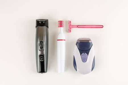 Different devices for depilation on a white background, top view