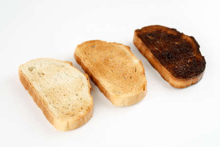 Three toast in different stages of roasting on white background