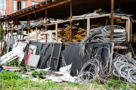 Old abandoned and ruined industrial building with shelves of rubbish