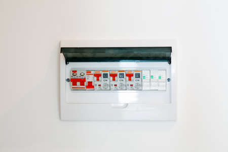 Electrical junction box on a white wall, close-up