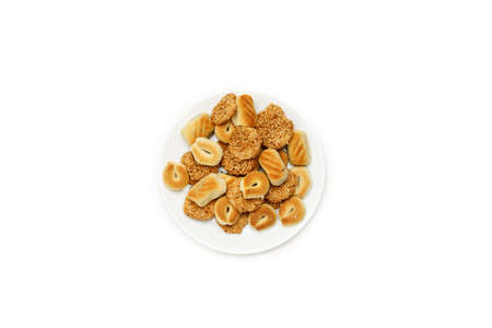 Traditional oriental cookies with sesame on a white table, top view