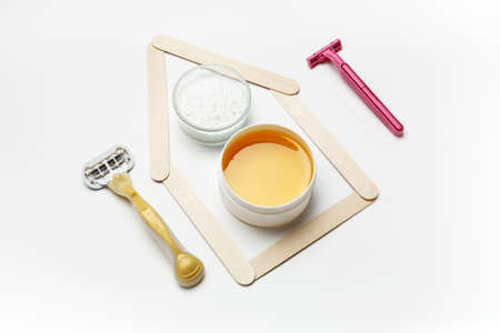 Tools for depilation on a white background, top view
