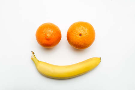 Smiling face made of fruits on a white background, top view 写真素材