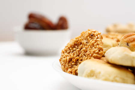Traditional oriental cookies with sesame and dates, macro shot