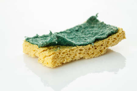 Used cleaning sponge on a white background Stock Photo