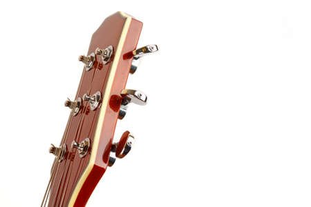 Acoustic guitar head on a white background, closeup