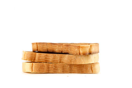 Slices of toasted bread on a white background 写真素材