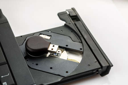Usb flash drive inside open cd tray of laptop