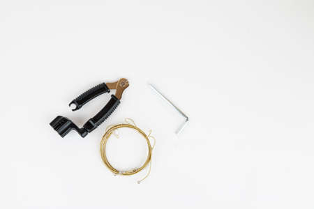 Tools for acoustic guitar strings change on a white background, top view Stok Fotoğraf