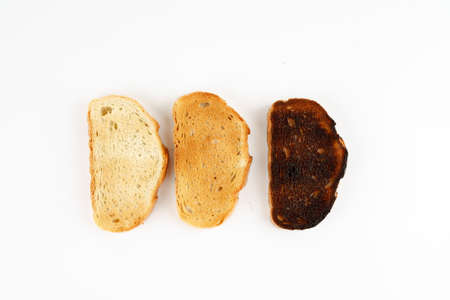 Three toasts in different stages of roasting, top view