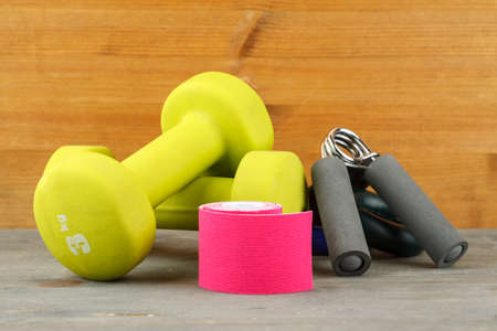 Sport equipment on a wooden table, closeup shot 写真素材