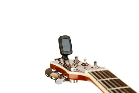 Hand tuning acoustic guitar with electronic tuner 写真素材 - 126219925