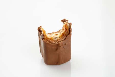 Bitten chocolate bar on a white, closeup 写真素材 - 126219927