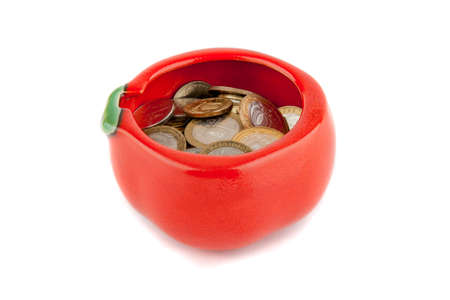 Red ceramic bowl with russian coins isolated on white