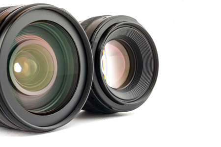 Two black photo lenses on white background
