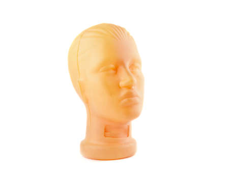 Plastic mannequin head isolated on white background