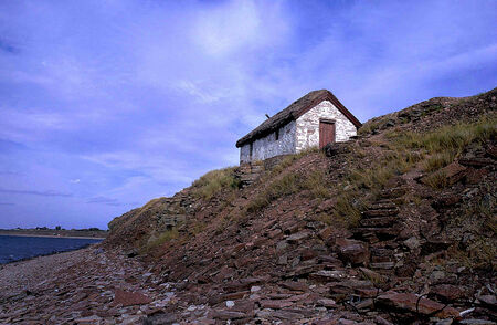 scarp: Withe small house on scarp