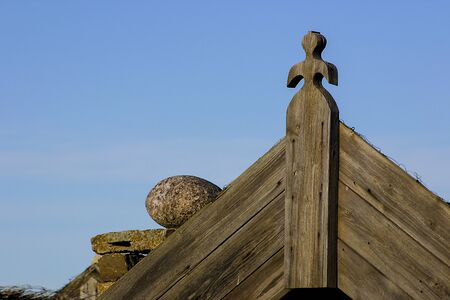 gable house: Part  of a gable on the house with wooden sculptures in the village Bruddesta Stock Photo