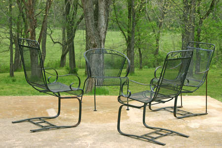 Four chairs wait for a good conversation in a park-like setting