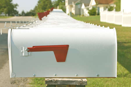 addresses: Many mailboxes in a row on a quiet street Stock Photo
