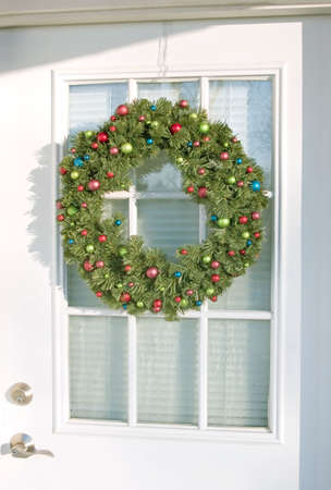 A Christmas Wreath on a white door. photo