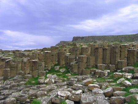 Standing and Tumbled Basalt Columns Stock Photo