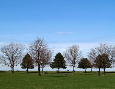 A quiet park on the edge of a large lake Stock Photo