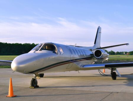 fuselage: Small business jet sits on the tarmac waiting for its passengers Stock Photo