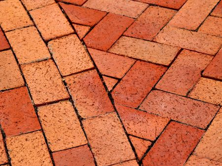 Curved and herringbone patterned brick walkway