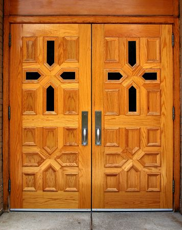 Set of double wooden church doors with cross patterns photo